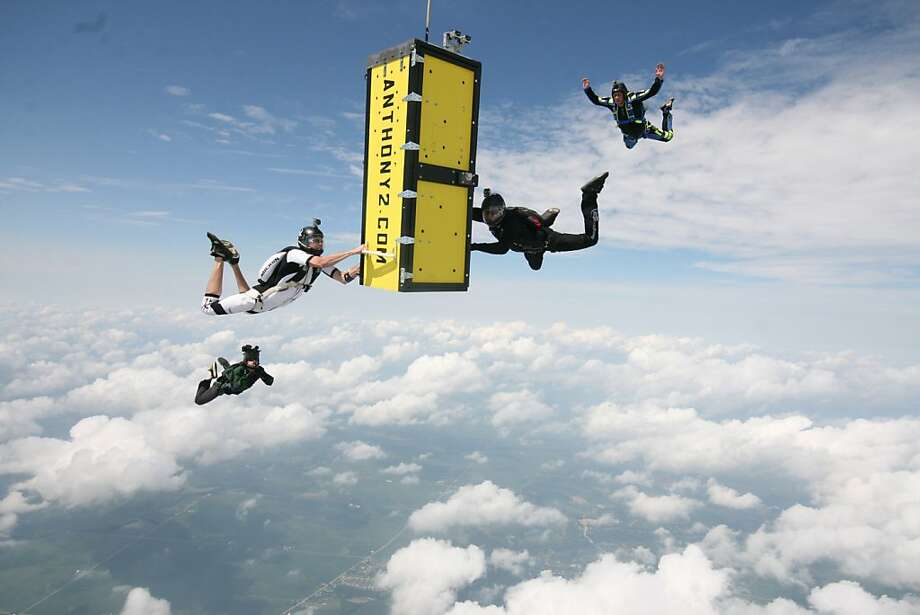 Great escape from falling crate:Handcuffed and locked inside a coffin plummeting to Earth, escape artist Anthony Martin tries to free himself after being dropped from an airplane 14,000 feet above northern Illinois. He managed to pick several locks, open the door of the box, somersault out and pull his chute at 6,500 feet. The 47-year-old Wisconsin man landed gently in a field of a farm in Serena. Photo: Joe Silva, Associated Press