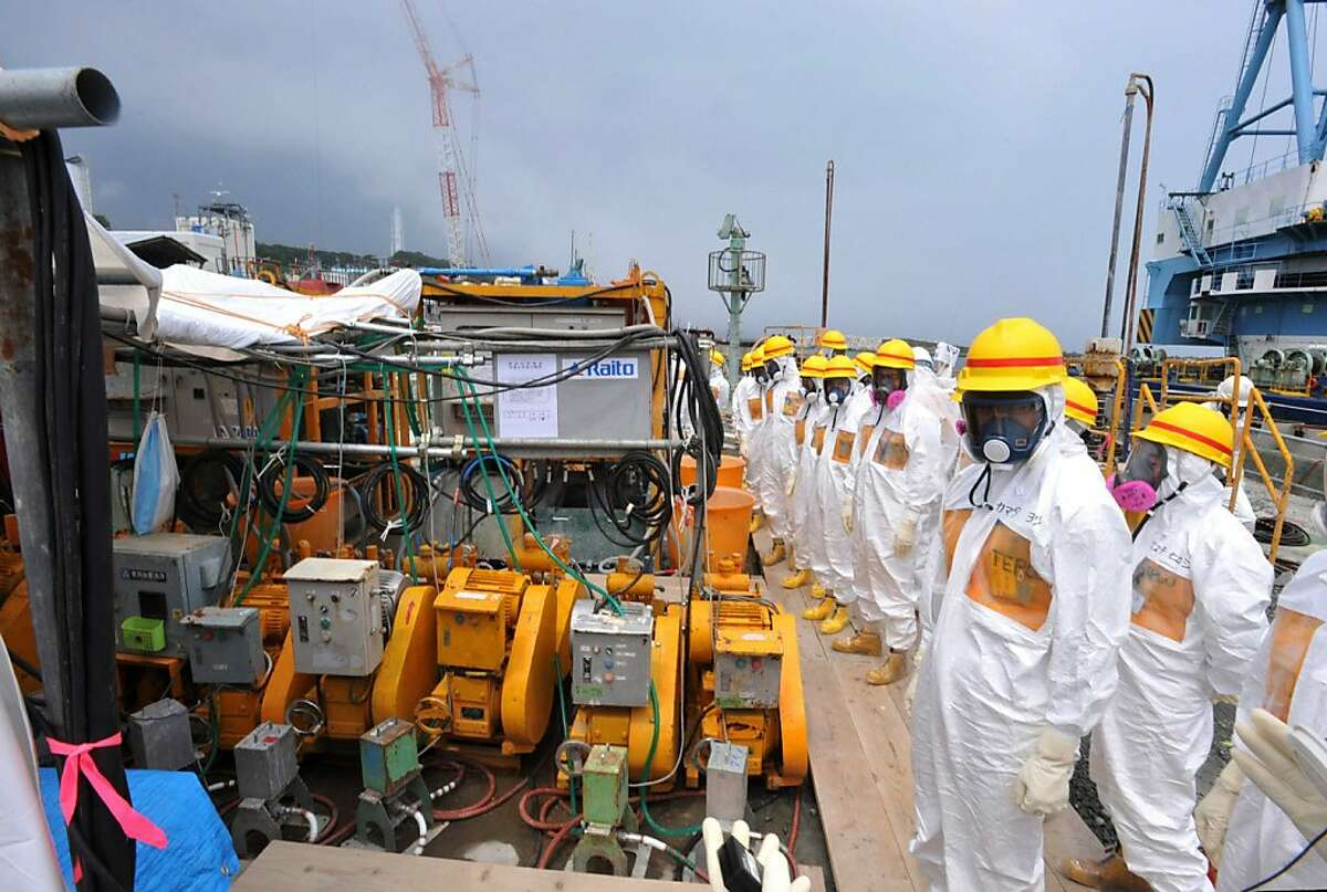 This photo taken on August 6, 2013 shows local government officials and nuclear experts inspecting a facility to prevent seeping of contamination water into the sea at Tokyo Electric Power's (TEPCO) Fukushima Dai-ichi nuclear plant in Okuma, Fukushima prefecture. Japan will accelerate efforts to prevent more radioactive groundwater from seeping into the ocean at the crippled Fukushima nuclear plant, government officials said on August 7, as critics slam its operator's handling of the issue.