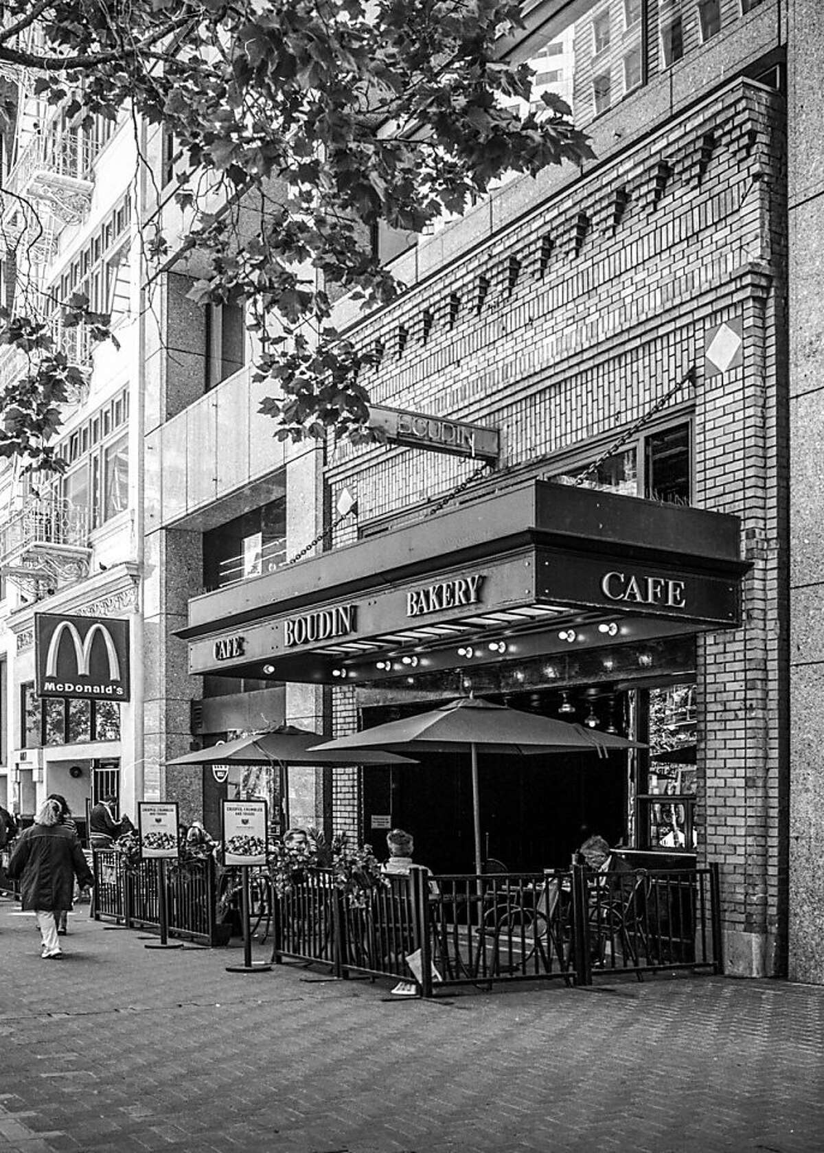 The Hoffman Grill on Market Street, saved in the 1980s by being absorbed into a new office tower, is among the subjects of a new exhibition on historic preservation at the SPUR Urban Center Gallery.