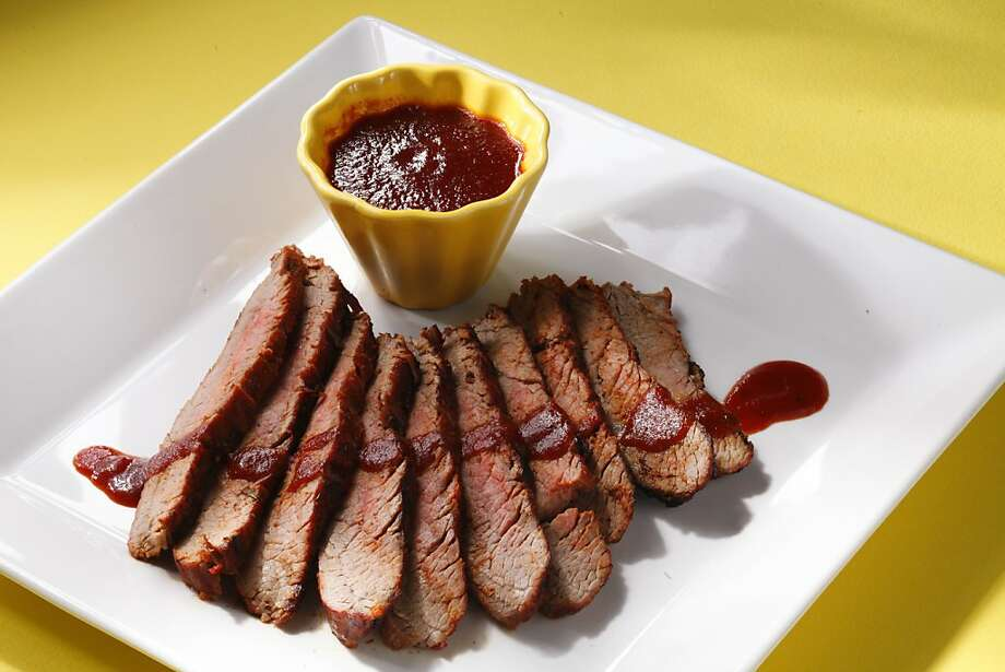 Dry-Rubbed Flank Steak With Spicy BBQ Sauce: Leftover steak will make great sandwiches the next day. Click here for the recipe. Photo: Craig Lee, Special To The Chronicle