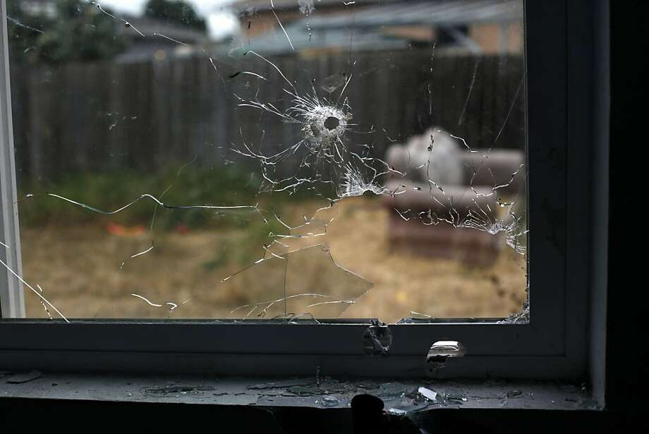 The window of the room in which Andrew Thomas, 20, and his 1-year-old son, Drew Jackson, were sleeping has holes where the bullets entered, killing Thomas at the scene. Baby Drew died at the hospital. Photo: Lacy Atkins, The Chronicle