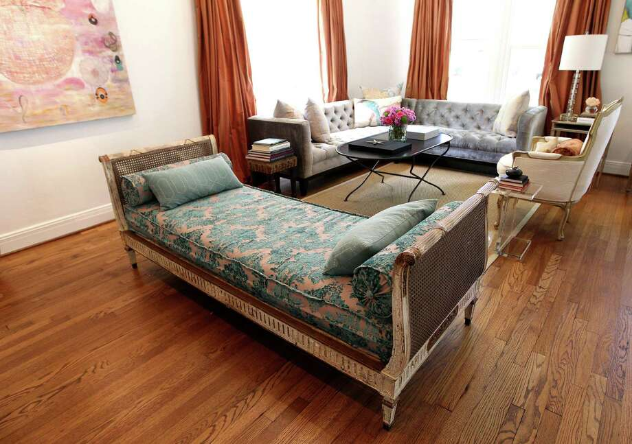 An antique day bed in the living room at the home of Shelley Calton. Photo: Karen Warren, Staff / © 2013 Houston Chronicle