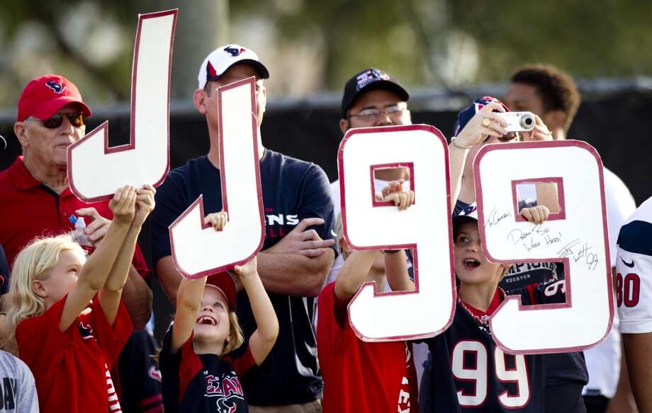 Fans cheer for Houston Texans defensive end J.J. Watt. Photo: Brett Coomer, Chronicle
