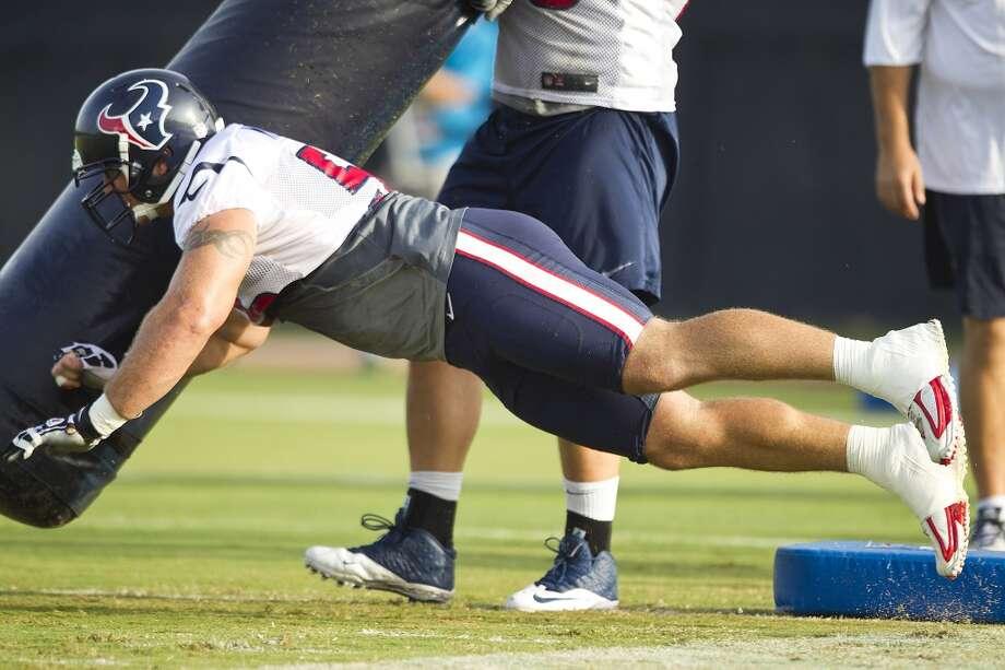 Center Chris Myers hits a blocking dummy. Photo: Brett Coomer, Chronicle