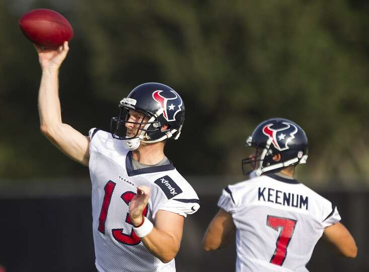 Quarterbacks T.J. Yates (13) and Case Keenum (7) drop back to throw.