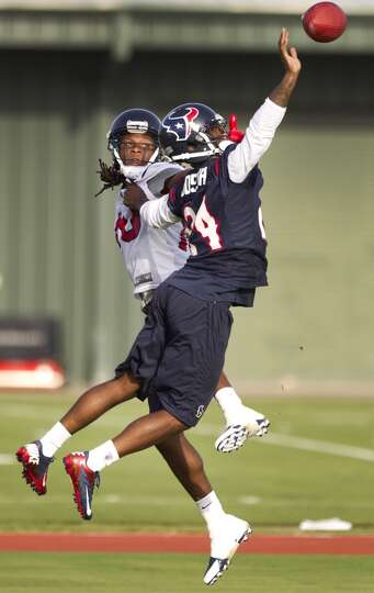 Cornerback Johnathan Joseph (24) breaks up a pass intended for wide receiver DeAndre Hopkins (10).