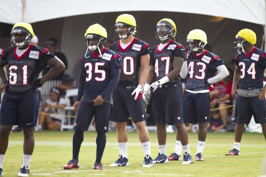 Bryan Collins (61), Eddie Pleasant (35), Bryan Braman (50), Justin Tuggle (47), Elbert Mack (43) and A.J. Bouye (34) line up for a kickoff. Photo: Brett Coomer, Chronicle