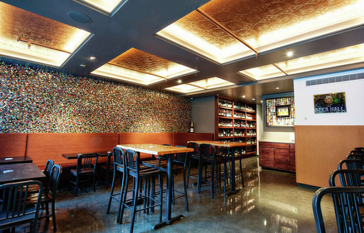 That mosaic behind the banquette consists of 14,000 bottlecaps.