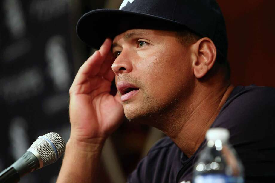 New York Yankees Alex Rodriguez holds a news conference after being suspended through 2014 for alleged use of performance-enhancing drugs. Photo: Charles Cherney, Associated Press