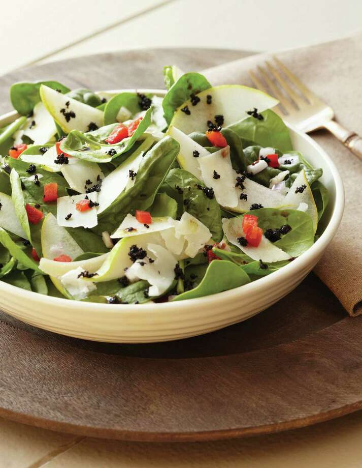 """""""Pear Salad with Chiangbai Ants,"""" from """"The Eat-a-Bug Cookbook""""3 cups baby spinach, washed and dried2 crisp pears, peeled, cored, and sliced1/2 cup chopped red bell pepper2 tablespoons finely chopped shallot2 tablespoons balsamic vinegar1 cup shaved Asiago or Parmesan cheese4 tablespoons dried Chiangbai antsYields 4 servingsArrange spinach on four salad plates, with a layer of pear slices on top. Sprinkle on bell pepper and shallots. Splash each salad with about 1/2 tablespoon of balsamic vinegar. Add cheese. Sprinkle ants over cheese. Recipe and photo reprinted with permission from """"The Eat-a-Bug Cookbook"""" by David George Gordon, Ten Speed Press, 2013.  Photo: -"""