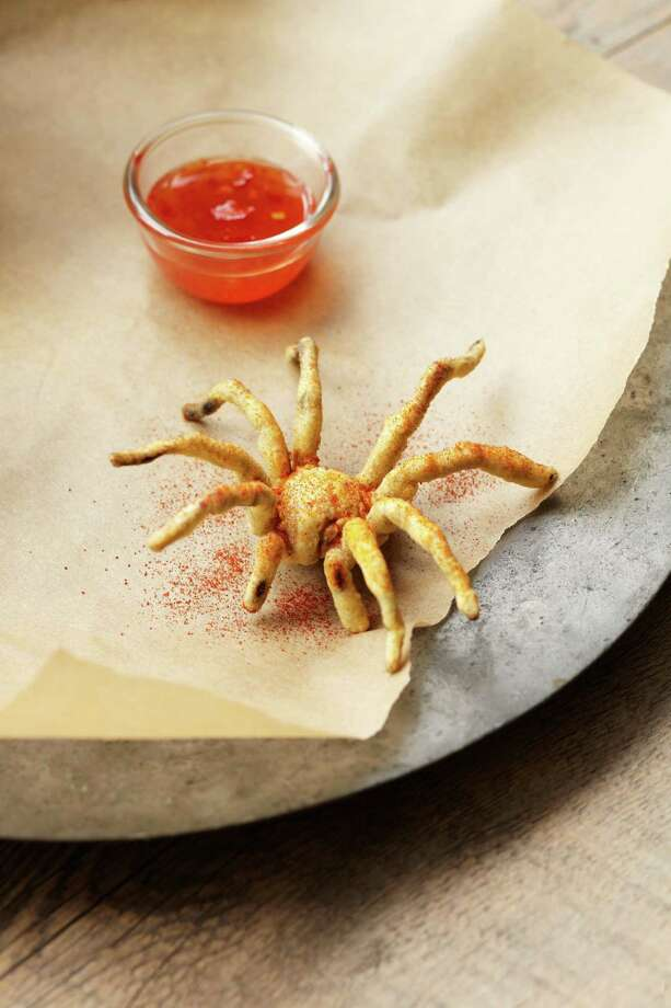 """Deep-Fried Tarantula Spider,"" from ""The Eat-a-Bug Cookbook"" 2 cups canola or veggie oil 2 frozen adult Texas brown, Chilean rose, or similar-sized tarantulas, thawed1 cup tempura batter1 teaspoon smoked paprikaHeat oil to 350 degrees in a deep saucepan or fryer. Sever and discard tarantula abdomens with a sharp knife. Singe off any spider hairs with crème brulee torch or cigarette lighter. Dip spiders in tempura batter and thoroughly coat. Use slotted spoon or hands to make sure each spider is spread-eagled (so to speak) and not clumped together, before dropping in hot oil. Deep-fry spiders one at a time, until batter is lightly browned, about 1 minute. Remove spider from oil and place on paper towels to drain. Use a sharp knife to cut spiders in half, length-wise. Sprinkle with paprika. Writes Gordon: ""Encourage your guests to try the legs first and, if still hungry, to nibble on the meat-filled mesothorax, avoiding the spider's paired fangs, which are tucked away in the head region.""Recipe and photo reprinted with permission from ""The Eat-a-Bug Cookbook"" by David George Gordon, Ten Speed Press, 2013.  Photo: -"