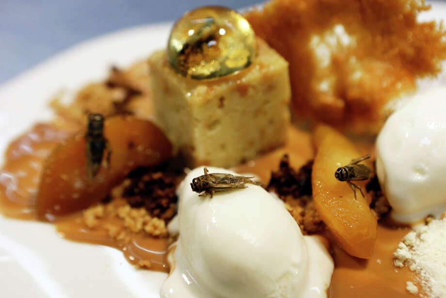 A close-up of French restaurant Aphrodite's dessert of crickets in whiskey bubbles, prepared by chef David Faure. Crickets have been described as tasting like nuts, fried shrimp or popcorn. Photo: VALERY HACHE, - / 2013 AFP