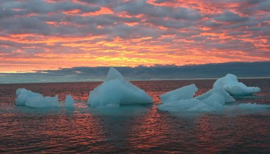 In this file photo, ice chunks float in the Arctic Ocean as the sun sets near Barrow, Alaska. Photo: Beth Ipsen, Artic Sounder