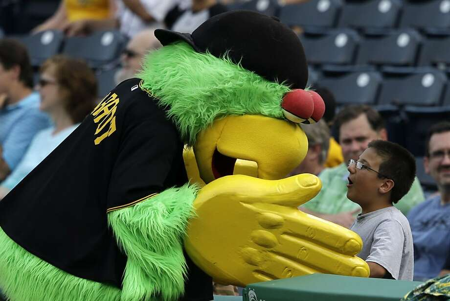 The Pittsburgh Pirate Parrot wouldn't be so bad if it weren't for its gigantic human hands (look at the fingernails!). It looks like it's about to slap this poor boy into the next county. Photo: Gene J. Puskar, Associated Press