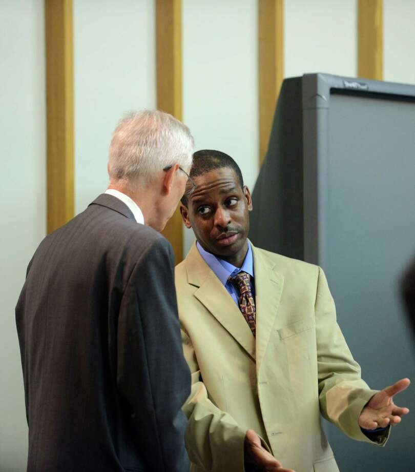 "Russell Peeler Jr. confers with defense attorney Robert Sullivan during his trial Wednesday, Aug. 7, 2013 in Bridgeport Superior Court in Bridgeport, Conn. Peeler is on trial for the 1998 shooting death of Rudolph Snead Jr. and has already been convicted and sentenced to death for ordering the murder of Karen Clarke and her eight-year-old son, Leroy ""B.J."" Brown Jr., in their Bridgeport, Conn. home in 1999. Photo: Autumn Driscoll / Connecticut Post"