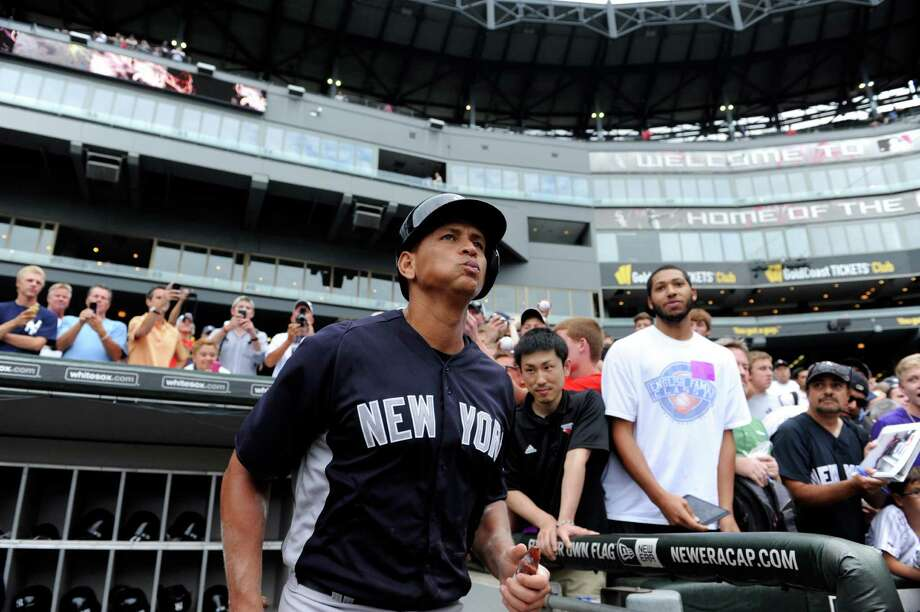 New York Yankees' Alex Rodriguez  leaves the dugout to take batting practice before a baseball game against the Chicago White Sox, Tuesday, Aug. 6, 2013 in Chicago. Photo: David Banks