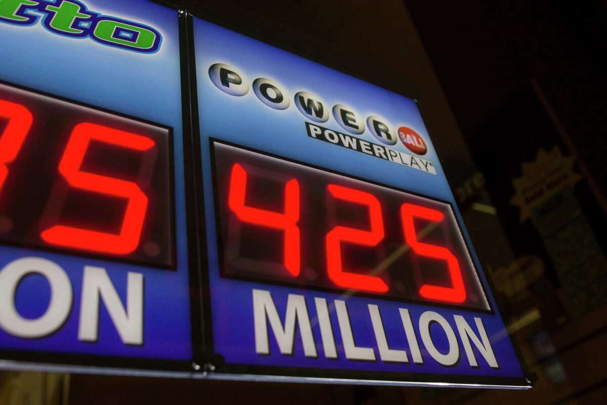 Signage showing the current jackpot of the Powerball outside of a convenience store in Chicago, Wednesday, Aug. 7, 2013. Ticketholders are hoping to win Wednesday's Powerball drawing, estimated at $425 million so far.