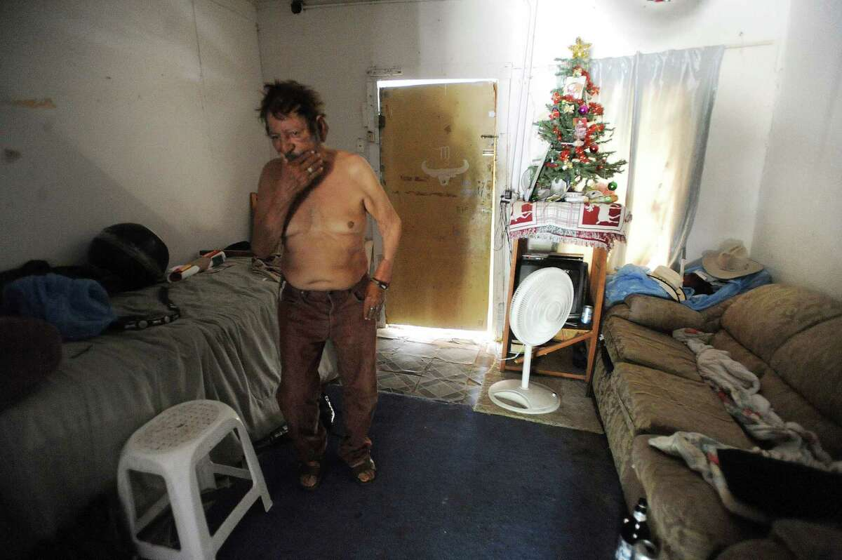 Javier Briones, 72, copes with the summer heat in his modest living space in Laredo, Texas, on Wednesday, Aug. 7, 2013. Briones has one fan to keep him cool. He often goes to a local HEB to keep cool.