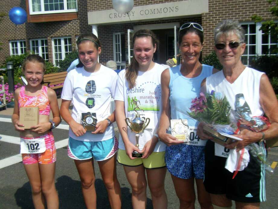 Betsy Overstrum, 11, Katie Overstrum, 15, Laura Holroyd ,21, Kris Overstrum, 51 and Betty Holroyd, 87, pose after running in the Wesley Village 5k last year in Shelton, Conn. Kris is Betty's daughter and Betsy, Katie and Laura are three of her grandchildren. The three generations plan on running again this yearâÄôs race on Aug. 24, 2013. Photo: Contributed Photo / Connecticut Post Contributed