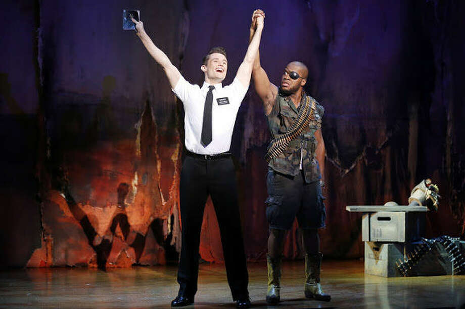 "Mark Evans (left) and Derrick Williams appear in a national tour of ""The Book of Mormon,"" which will kick off the 2013-2014 ""Broadway in San Antonio Series"" at the Majestic Theatre. Photo: Courtesy Joan Marcus"