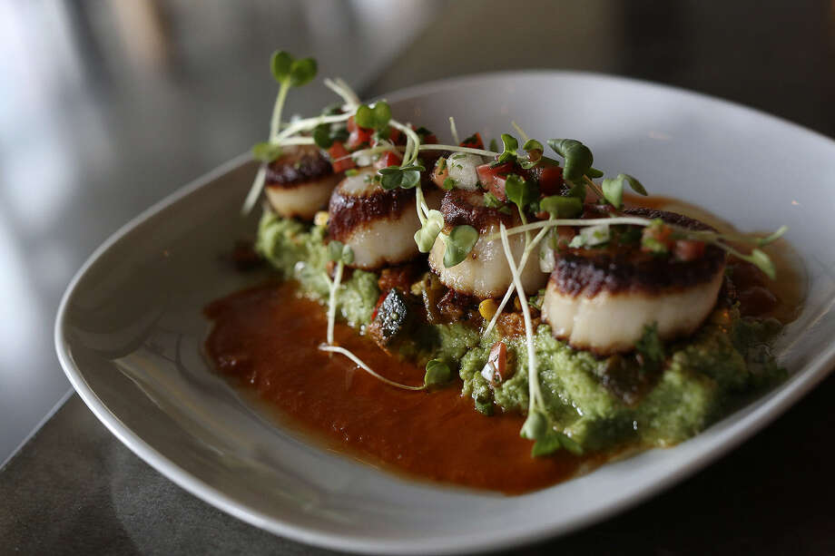 George's Bank Diver Sea Scallops are a highlight of the menu at Arcade Midtown Kitchen at The Pearl. Photo: Express-News File Photo