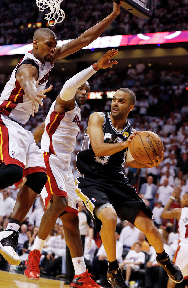 San Antonio Spurs' Tony Parker looks to pass around Miami Heat's Chris Bosh and Miami Heat's LeBron James during overtime during Game 6 of the 2013 NBA Finals Tuesday, June 18, 2013 at American Airlines Arena in Miami. (Edward A. Ornelas/San Antonio Express-News) Photo: San Antonio Express-News / © 2013 San Antonio Express-News