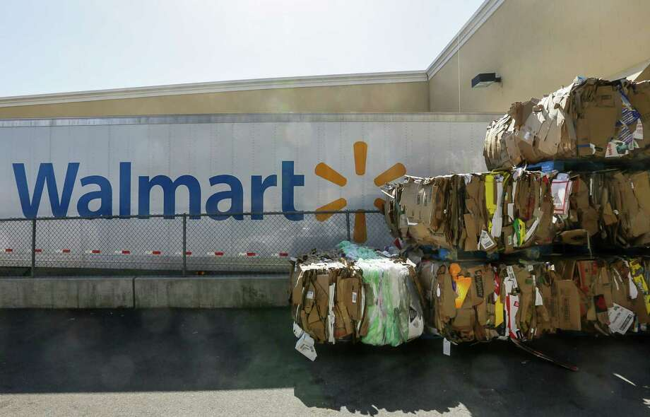 FILE - In this May 28, 2013, file photo, recycled cardboard boxes are ready for transport outside a Walmart store in Duarte, Calif. Wal-Mart agreed Wednesday, Aug. 7, 2013, to improve safety conditions for employees who use trash compactors and cleaning chemicals at more than 2,800 stores as part of a settlement agreement with the Labor Department.. (AP Photo/Damian Dovarganes, File) ORG XMIT: NYBZ153 Photo: Damian Dovarganes / AP