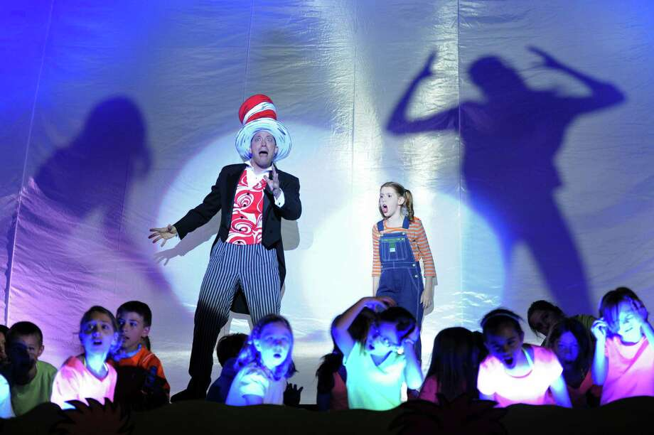 John Tartaglia, playing Cat in the Hat, and Jane Shearin, playing JoJo, act out a scene during the dress rehearsal of Seussical at Newtown High School in Newtown, Conn. on Wednesday, August 7, 2013.  The performance, presented by the 1214 Foundation, features Broadway actor John Tartaglia and over 80 students from the Newtown area.  Shows will be Friday, Aug. 9 at 7 p.m., Saturday at 2 p.m. and 7 p.m., and Sunday at 2 p.m. Photo: Tyler Sizemore / The News-Times