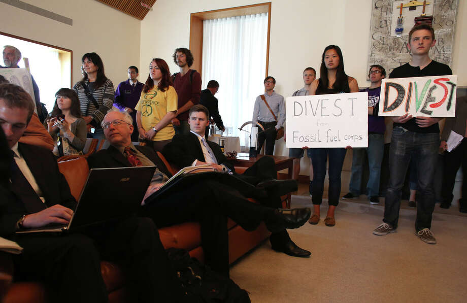 Students gather during a meeting of the University of Washington Board of Regents on Thursday, June 13, 2013. Students gathered during the meeting to ask the school to divest the university's investment portfolio of all stocks in big oil, big coal, and all companies involved in the fossil-fuel economy. Photo: JOSHUA TRUJILLO, SEATTLEPI.COM / SEATTLEPI.COM