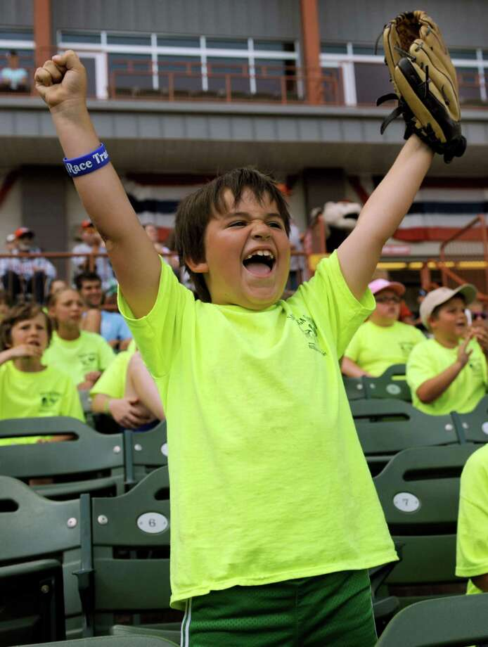 Carson Correa, 7, with Camp Saradac Recreation Center in Saratoga Springs celebrates a good play on Camp Day Wednesday, Aug. 7, 2013, as the Tri-City ValleyCats took on the Williamsport Crosscutters at Bruno Stadium in Troy N.Y. (Cindy Schultz / Times Union) Photo: Cindy Schultz / 10023387A