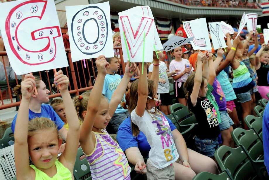 Children with the Colonie Youth Center hold up sign as they celebrate a home run on Camp Day  Wednesday, Aug. 7, 2013, as the Tri-City ValleyCats took on the Williamsport Crosscutters at Bruno Stadium in Troy N.Y. (Cindy Schultz / Times Union) Photo: Cindy Schultz / 10023387A