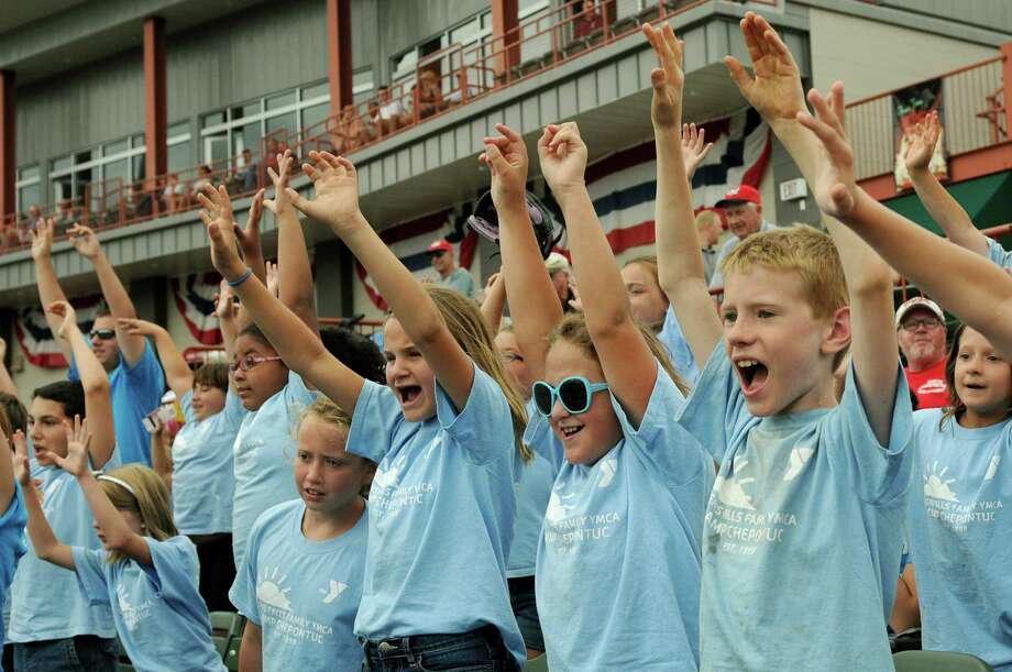Children with the Glens Falls YMCA Camp Chepontuc cheer for freebies on Camp Day Wednesday, Aug. 7, 2013, as the Tri-City ValleyCats took on the Williamsport Crosscutters at Bruno Stadium in Troy N.Y. (Cindy Schultz / Times Union) Photo: Cindy Schultz / 10023387A