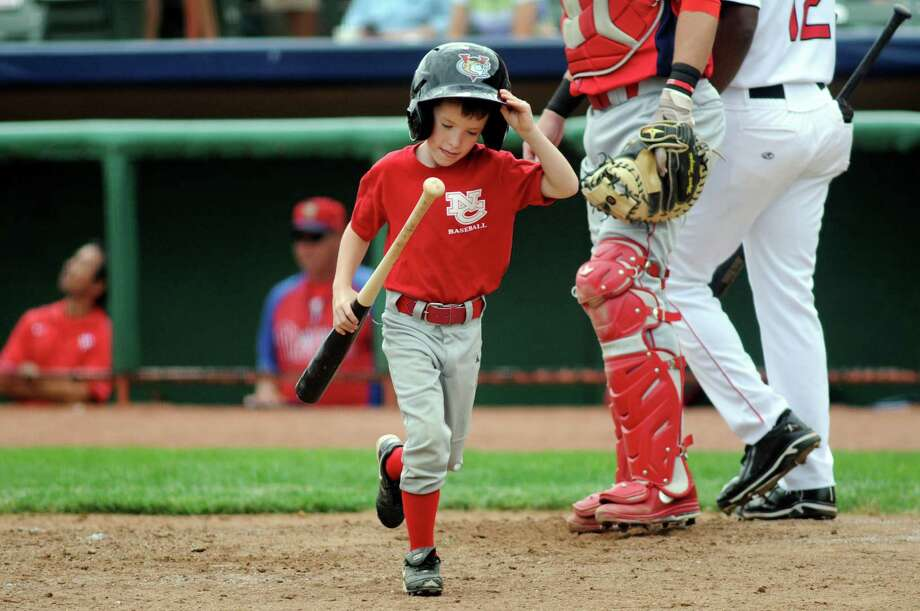 Tri-City ValleyCats bat boy Jacob Frank, 7, left, adjusts his too big hat during Wednesday's game against the  Williamsport Crosscutters Aug. 7, 2013, at Bruno Stadium in Troy N.Y. (Cindy Schultz / Times Union) Photo: Cindy Schultz / 10023387A