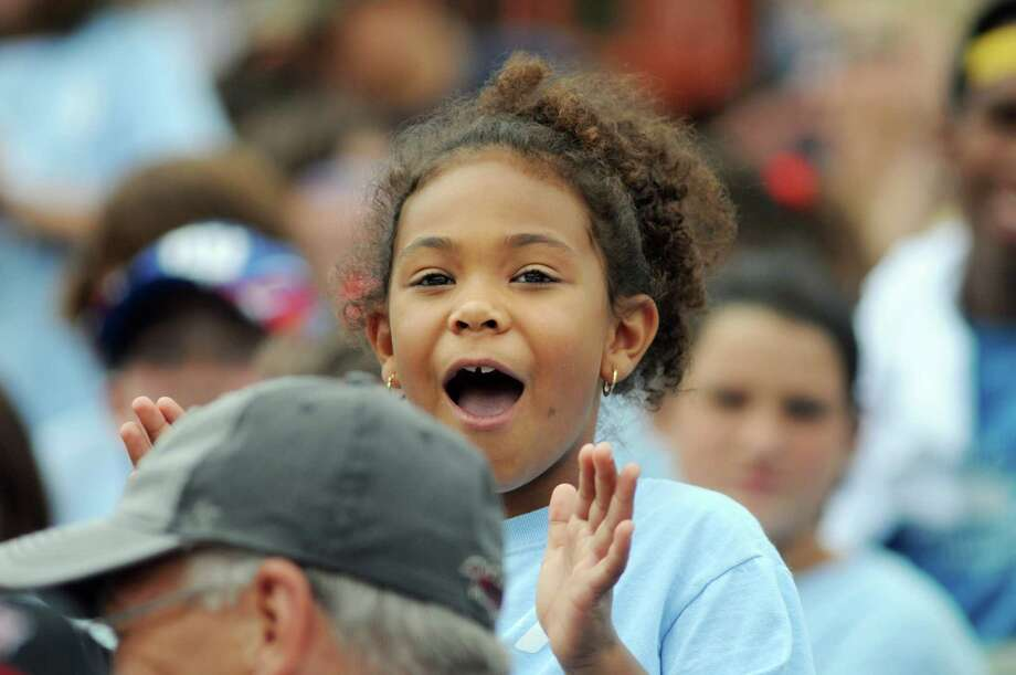 Meah Hercules, 6, with the Glens Falls YMCA Camp Chepontuc cheers for his team on Camp Day Wednesday, Aug. 7, 2013, as the Tri-City ValleyCats took on the Williamsport Crosscutters at Bruno Stadium in Troy N.Y. (Cindy Schultz / Times Union) Photo: Cindy Schultz / 10023387A