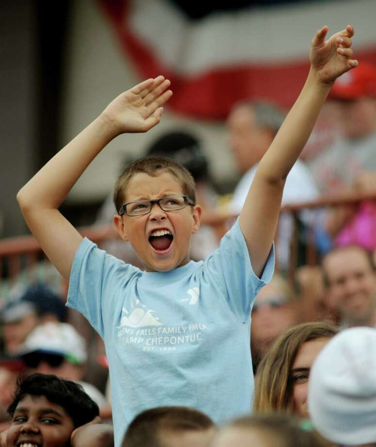 Mikey Marrero, 13, with the Glens Falls YMCA Camp Chepontuc cheers for his team on Camp Day Wednesday, Aug. 7, 2013, as the Tri-City ValleyCats took on the Williamsport Crosscutters at Bruno Stadium in Troy N.Y. (Cindy Schultz / Times Union) Photo: Cindy Schultz / 10023387A