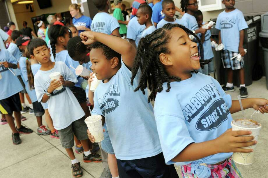 Children with the Albany Police Athletic League dance to the music during a beverage break on Camp Day  Wednesday, Aug. 7, 2013, as the Tri-City ValleyCats took on the Williamsport Crosscutters at Bruno Stadium in Troy N.Y. (Cindy Schultz / Times Union) Photo: Cindy Schultz / 10023387A