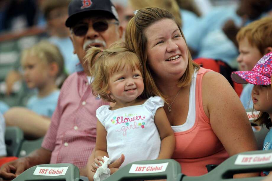 Lilly Knickerbocker, 2, of Castleton, center, and her mother, Emily, watch the entertainment  Wednesday, Aug. 7, 2013, as the Tri-City ValleyCats took on the Williamsport Crosscutters at Bruno Stadium in Troy N.Y. (Cindy Schultz / Times Union) Photo: Cindy Schultz / 10023387A