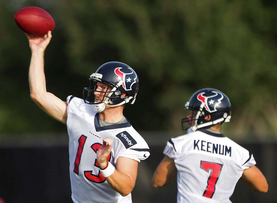 Third-year pro T.J. Yates, left, has the edge on Case Keenum in NFL game experience as they vie for the backup quaterback role during the Texans' four preseason games, beginning Friday night in Minnesota. Photo: Brett Coomer, Staff / © 2013 Houston Chronicle