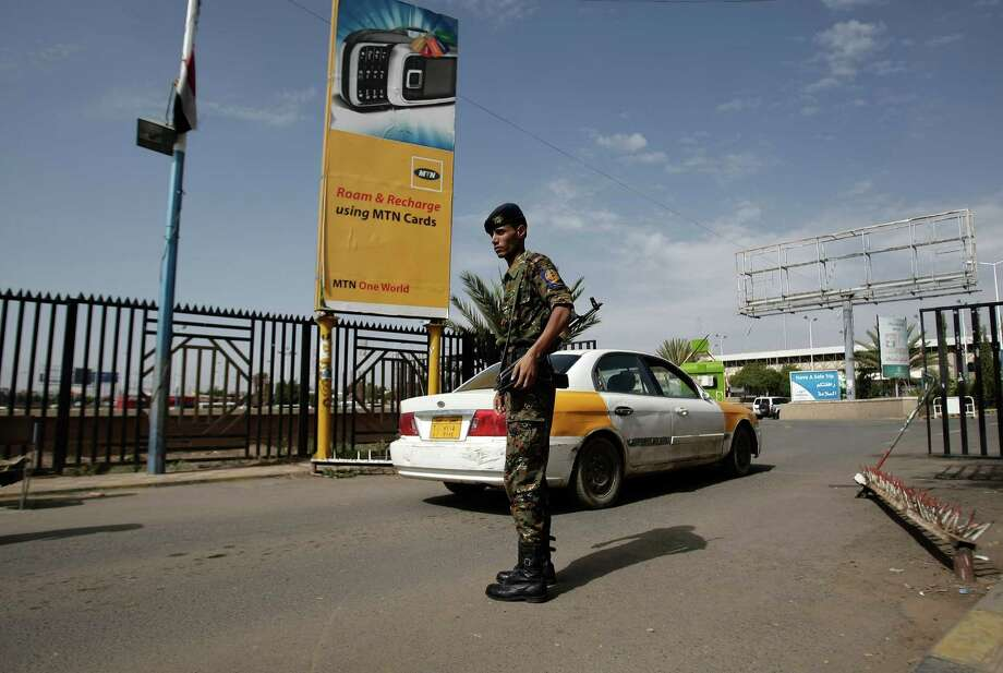 """A policeman stands guard at the entrance of Sanaa International Airport, Yemen, Wednesday, Aug. 7, 2013. The State Department on Tuesday ordered non-essential personnel at the U.S. Embassy in Yemen to leave the country. The department said in a travel warning that it had ordered the departure of non-emergency U.S. government personnel from Yemen """"due to the continued potential for terrorist attacks"""" and said U.S. citizens in Yemen should leave immediately because of an """"extremely high"""" security threat level. (AP Photo/Hani Mohammed) ORG XMIT: AHM107 Photo: Hani Mohammed / AP"""