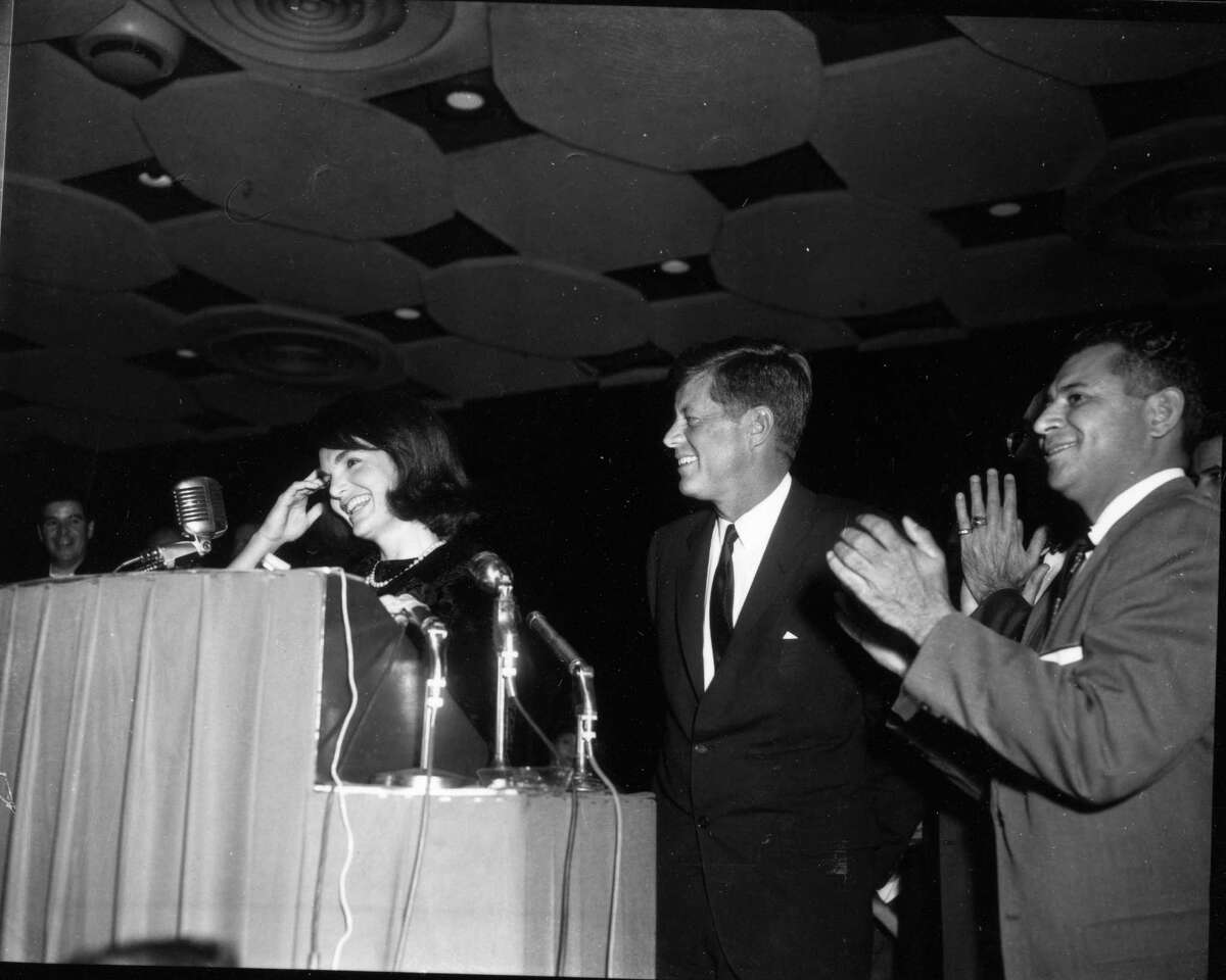 First lady Jacqueline Kennedy addresses Houston's League of United Latin American Citizens with President John F. Kennedy and David Adame in 1963.