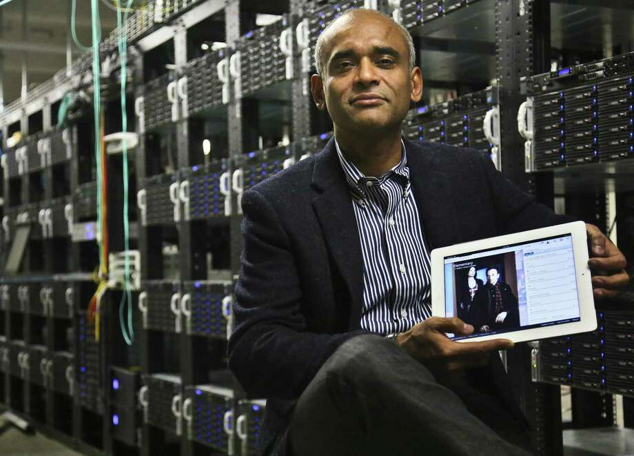 In this Thursday, Dec. 20, 2012, photo, Chet Kanojia, founder and CEO of Aereo, Inc., shows a tablet displaying his company's technology, in New York. Aereo is one of several startups created to deliver traditional media over the Internet without licensing agreements. Past efforts have typically been rejected by courts as copyright violations. In Aereo's case, the judge accepted the company's legal reasoning, but with reluctance. (AP Photo/Bebeto Matthews) Photo: Bebeto Matthews, Associated Press / AP