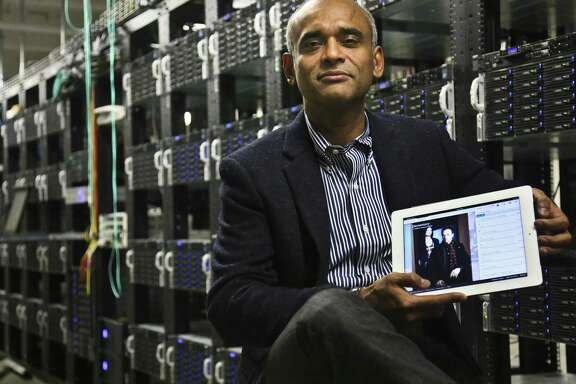 In this Thursday, Dec. 20, 2012, photo, Chet Kanojia, founder and CEO of Aereo, Inc., shows a tablet displaying his company's technology, in New York. Aereo is one of several startups created to deliver traditional media over the Internet without licensing agreements. Past efforts have typically been rejected by courts as copyright violations. In Aereo's case, the judge accepted the company's legal reasoning, but with reluctance. (AP Photo/Bebeto Matthews)