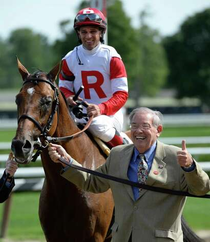 Owner Ken Ramsey, right leads Hyper with jockey Javier Castellano in the saddle to the winner's circle after winning the 10th running of The John's Call July 31, 2013 at the Saratoga Race Course in Saratoga Spings, N.Y.      (Skip Dickstein/Times Union) Photo: SKIP DICKSTEIN