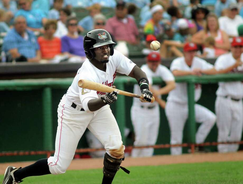 Tri-City ValleyCats' D'Andre Toney attempts a bunt during during Wednesday's game against the Williamsport Crosscutters Aug. 7, 2013, at Bruno Stadium in Troy N.Y. (Cindy Schultz / Times Union) Photo: Cindy Schultz / 10023387A
