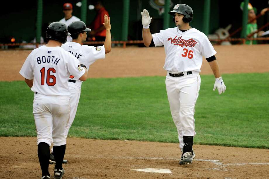 Tri-City ValleyCats Michael Martinez, right, celebrates his home run hit against the Williamsport Crosscutters Wednesday, Aug. 7, 2013, at Bruno Stadium in Troy N.Y. (Cindy Schultz / Times Union) Photo: Cindy Schultz / 10023387A