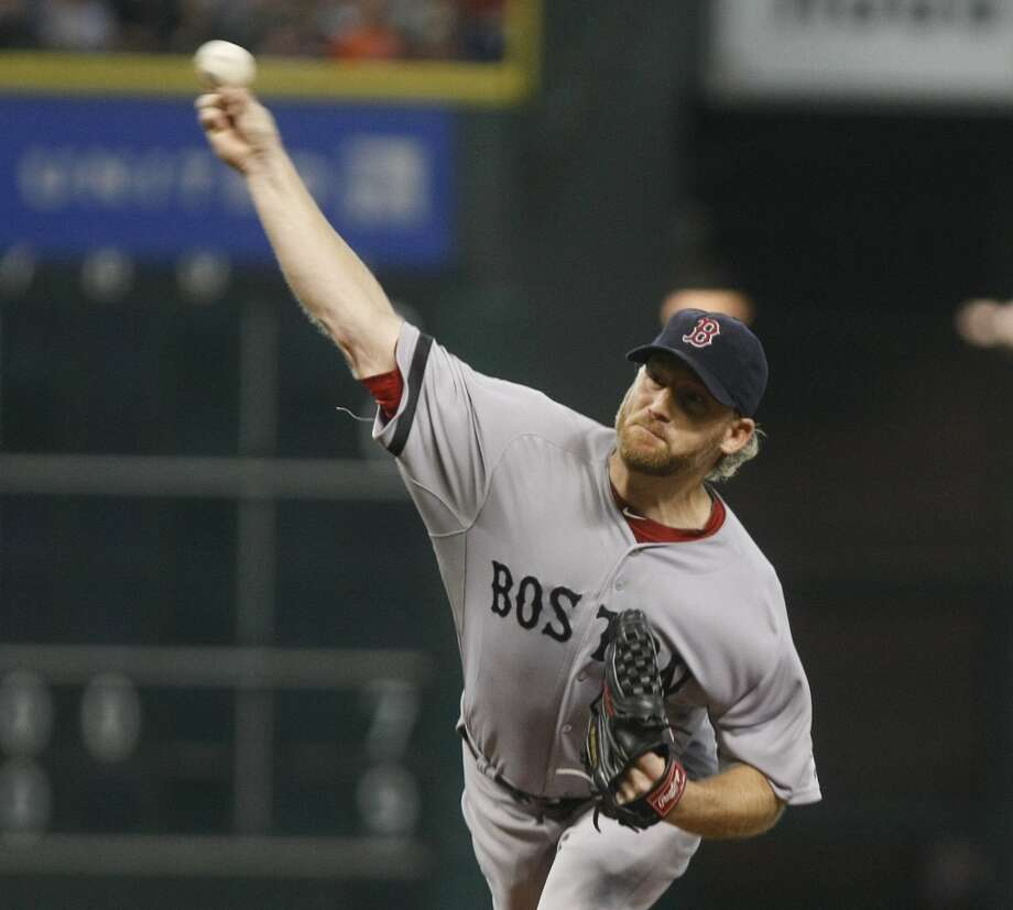 Red Sox starting pitcher Ryan Dempster pitches in the first inning. Photo: Johnny Hanson, Houston Chronicle