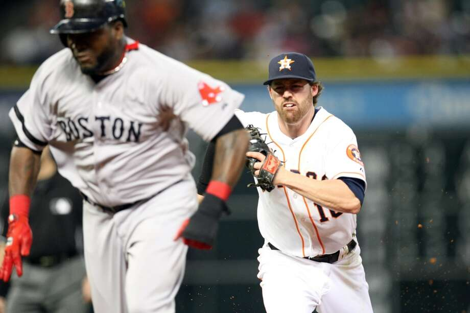 Astros second baseman Jake Elmore runs down Red Sox designated hitter David Ortiz and tags him out. Photo: Johnny Hanson, Houston Chronicle