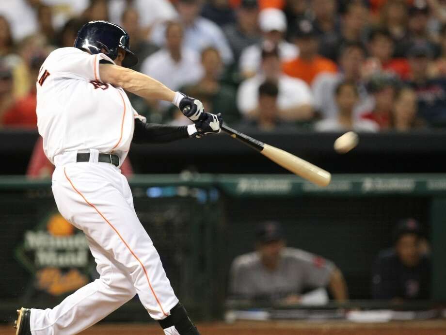 Astros center fielder Robbie Grossman hits a two-run home run. Photo: Johnny Hanson, Houston Chronicle