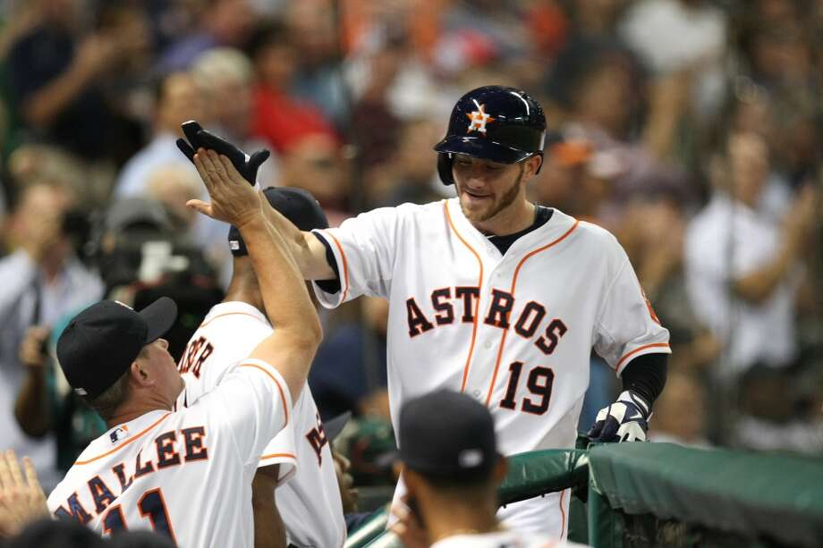 Astros center fielder Robbie Grossman is congratulated after his home run. Photo: Johnny Hanson, Houston Chronicle