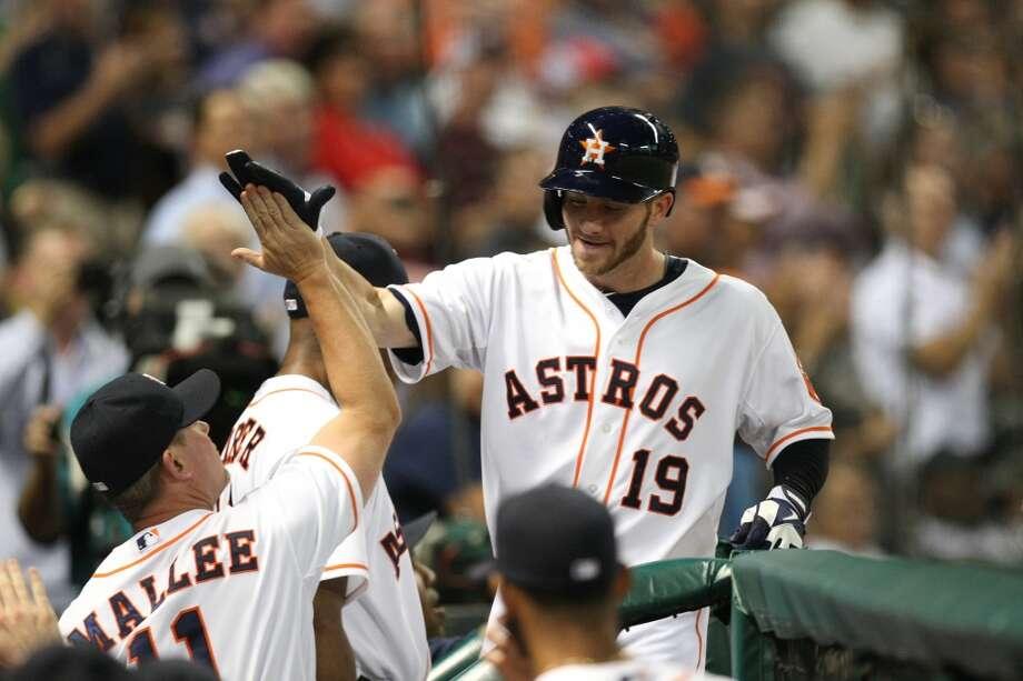 Astros center fielder Robbie Grossman is congratulated after his home run. Photo: Johnny Hanson, Houston Chronicle